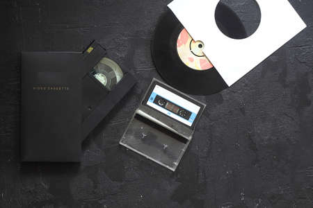Vinyl record, cd, audio and video cassettes top view Archivio Fotografico