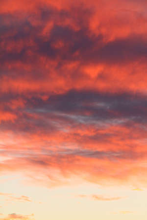 Dramatic red and orange sky and clouds abstract background. Red-orange clouds on sunset sky. Warm weather background.