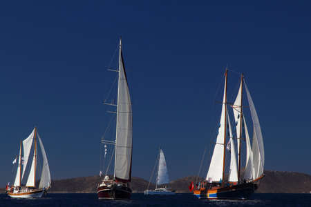 Bodrum, Turkey, 27 October 2018: Bodrum Sailing Cup, Gulet Wooden Sailboats and sailing yachts racing. Foto de archivo - 160787864