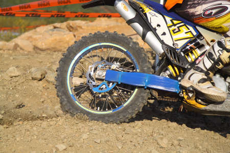Bodrum, Turkey, 07 November 2015: The 6. leg races  of Turkey Enduro Championship has been made by the organization of Turkey Motorcycle Federation. Close-up of motocross wheel.