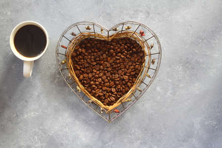 coffee in a heart shaped bowl. With coffee cup.