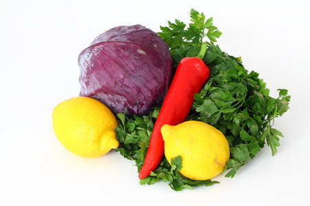 red cabbage, carrot, lemon, pepper, parsley isolated on white background.