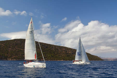 Bodrum, Turkey. 08 October 2017: Sailing in the wind through the waves at the Sea. Close up of sailing boat, sail boat or yacht at sea with white sails. Éditoriale