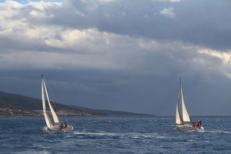 Bodrum, Turkey. 09 December 2017: Sailboats sail in windy weather in the blue waters of the Aegean Sea, on the shores of the famous holiday destination Bodrum.