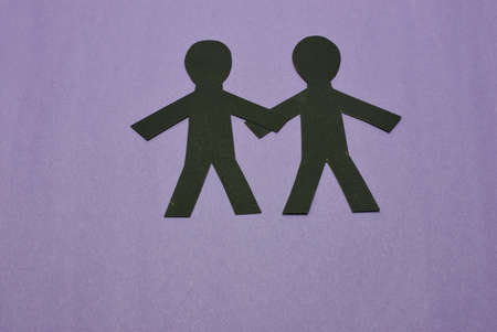 two male silhouettes in black on purple background