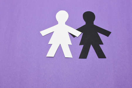one black, one white, female silhouettes on purple background Imagens