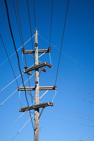 power lines, insulator, wooden pole