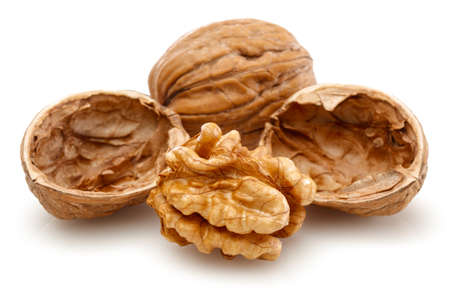 Peeled walnut and its kernels. Isolated on a white background