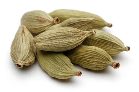 cardamum: Cardamom seeds on a white background. Stock Photo