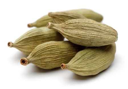 Cardamom seeds on a white background. Reklamní fotografie