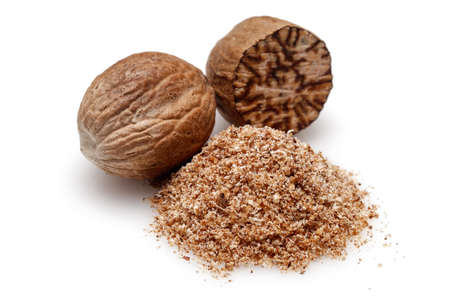 Nutmeg and ground nutmeg on white background.