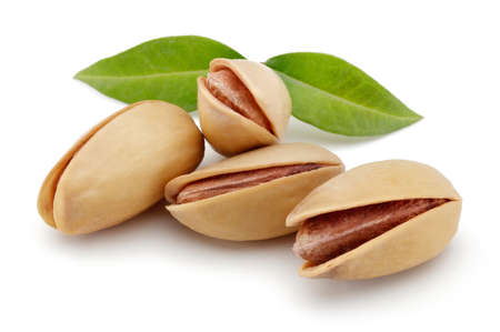 Pistachios nut with leaves isolated on a white background