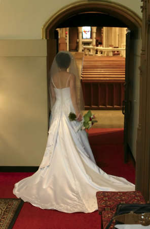 Bride Waiting to Enter the Church On Her Wedding Day photo