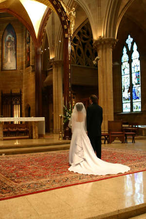 Bride and Groom at Altar (portrait)