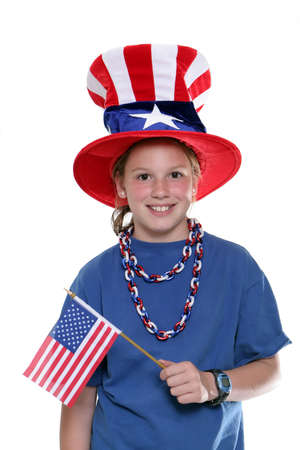 allegiance: Patriotic young girl waving flag and wearing a patriotic hat isolated against a white background.