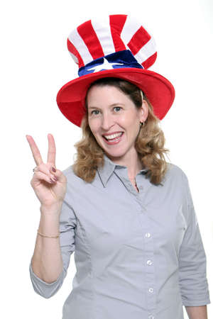 allegiance: Patriotic woman showing the peace symbol isolated against a white background.