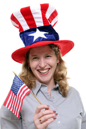 allegiance: Patriotic lady waving a small American Flag and wearing a patriotic hat isolated against a white background.