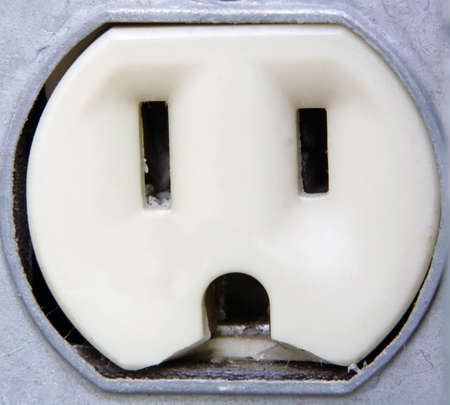 Extreme Closeup of an outdoor metal electrical outlet. photo