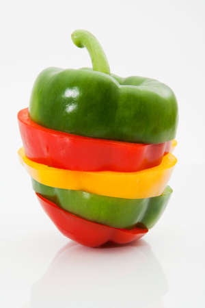 Sliced and mixed sweet pepper on a white background