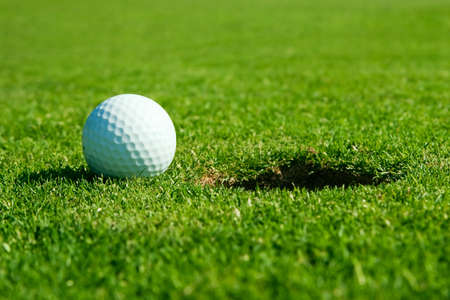 macro photo from golf ball and hole Stock Photo - 8046488