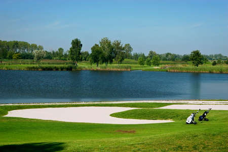 club scene: golf field with golf bags Stock Photo