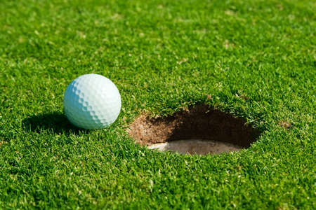 golf ball and hole  photo