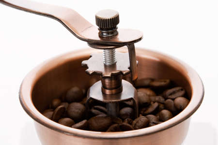 Old fashioned coffee mill with coffee beans Stock Photo - 9897886