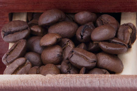 Macro photo from a coffee mill case with coffee beans