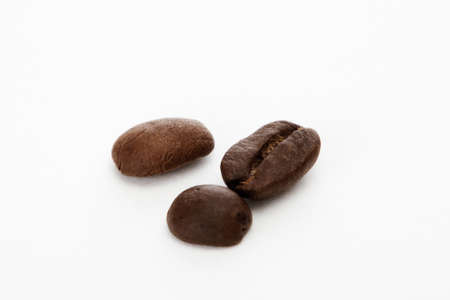 Three coffee beans in white background