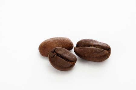 instant coffee: Three coffee beans in white background