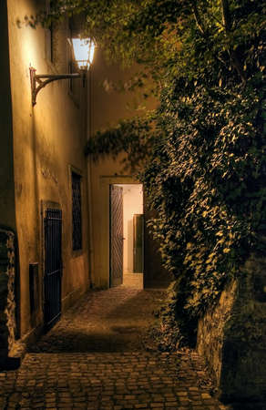 old styled: Abandoned alley in night width old styled lighting  Stock Photo