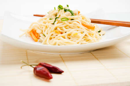 Thai food with dried chili peppers and chopsticks  Stock Photo