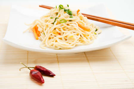 entree: Thai food with dried chili peppers and chopsticks  Stock Photo