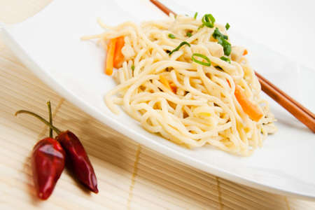 asian noodle: Thai food with dried chili peppers and chopsticks  Stock Photo