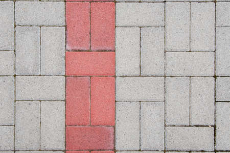 Concrete bricks with symmetrical pattern and red line