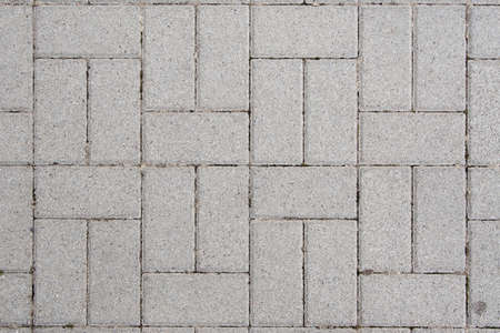 Concrete bricks with symmetrical pattern photo