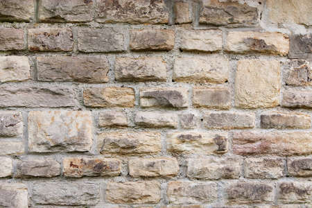Wall texture with aged, old stones Stock Photo