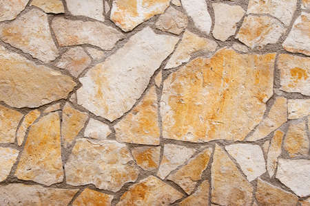 yellow wall: Wall texture with different type and color of stones