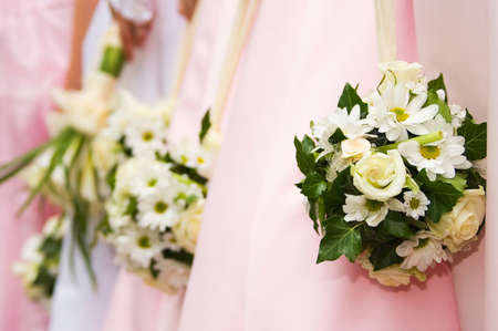 Bride bouquet and bridesmaid bouquets in the background