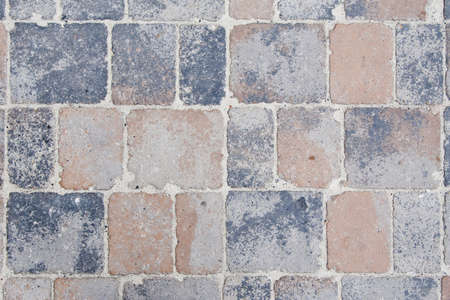 Concrete sidewalk texture with different sized and colored parts