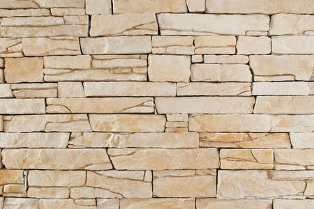 Wall texture from different sized and formed stones photo