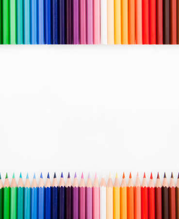 Top view of colored pencils with free, white place in the middle  Stock Photo