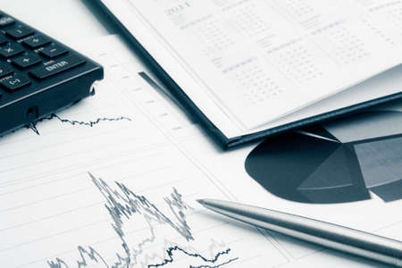 Business background with charts, pen, calculator and calendar