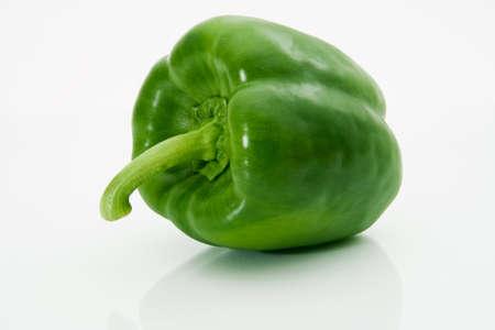 Green sweet pepper macro on a white background