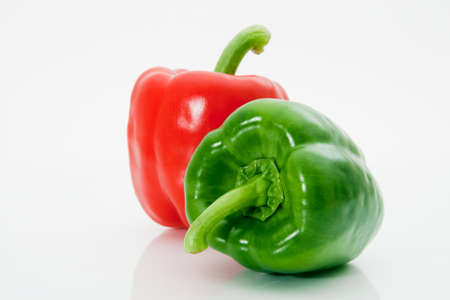 Red and green sweet peppers macro on a white background