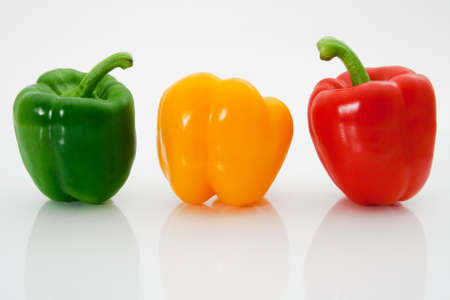 Three sweet peppers on a white background