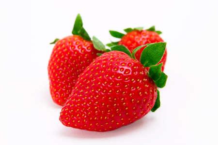 Fresh strawberries isolated on white background.