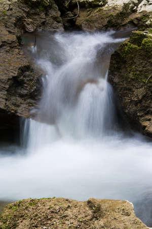 Little cascade macro photo with rocks