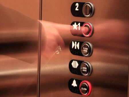 Business Woman Pressing Elevator Button