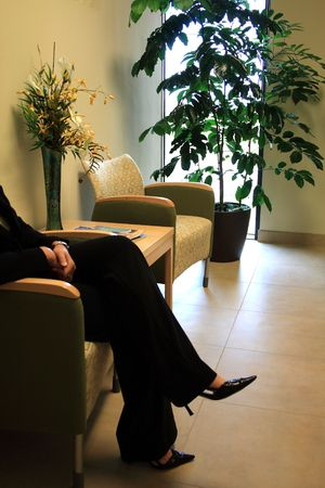 Business Woman in Waiting room Stock Photo
